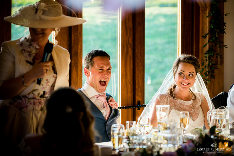 Groom laughing during amazing speeches at Sandhole Oak Barn