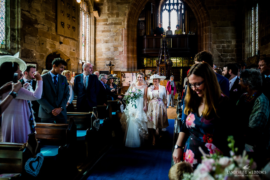 Gorgeous photo of Mum walking her daughter down the isle at Gawsworth Church