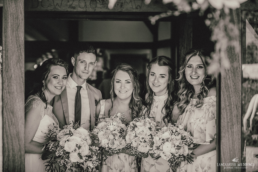 Gorgeous black and white photo capturing the bride and her maids at Sandhole Oak Barn