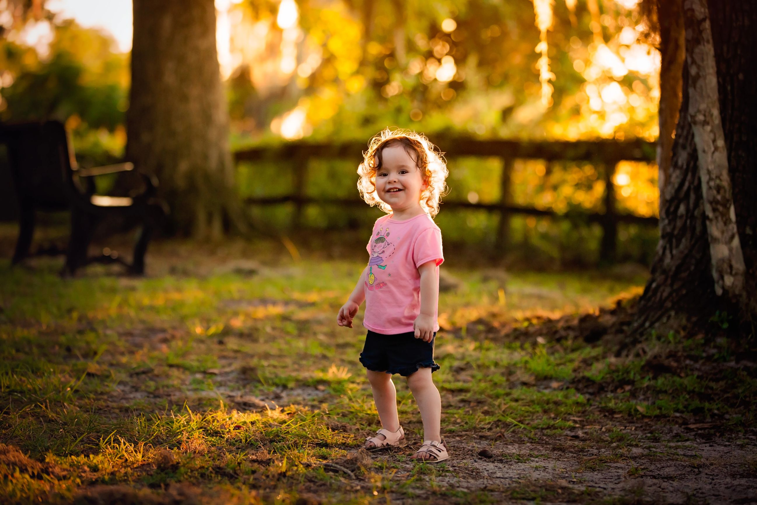 Portrait of a toddler during golden hour looking beautiful in St Johns County taken by Alyssa Renee Photography
