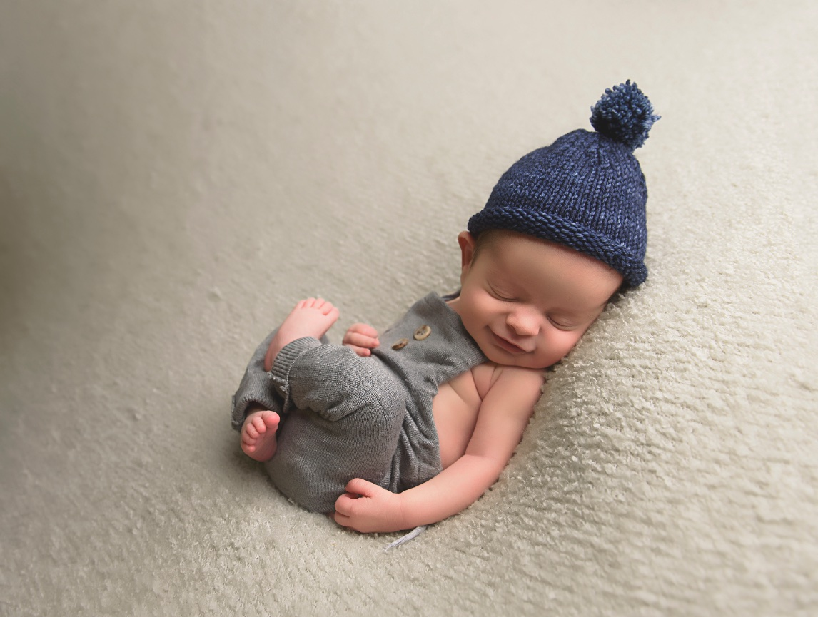 A newborn session with all the squishy newborn poses as well as use of my props parents and siblings included