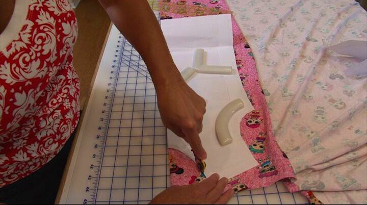 Watch this video demonstration of cutting pattern pieces using a rotary cutter and self healing mat