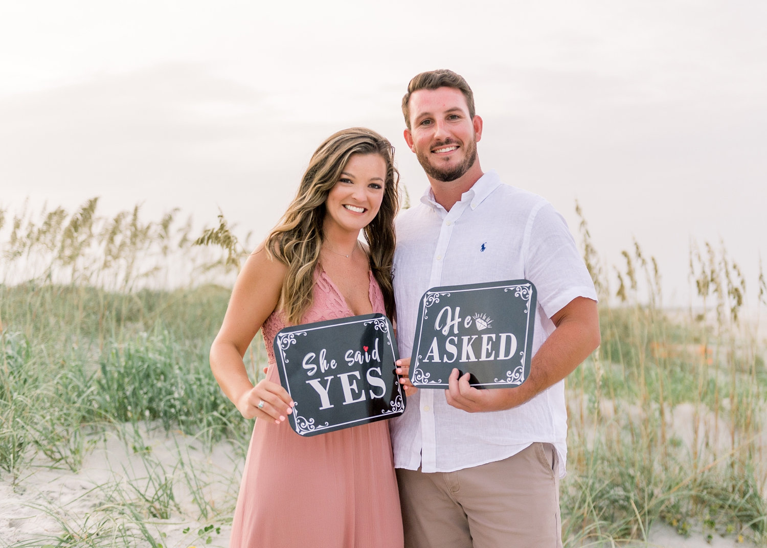 he asked she said yes signs, couple holding engagement signs, Rya Duncklee Photos