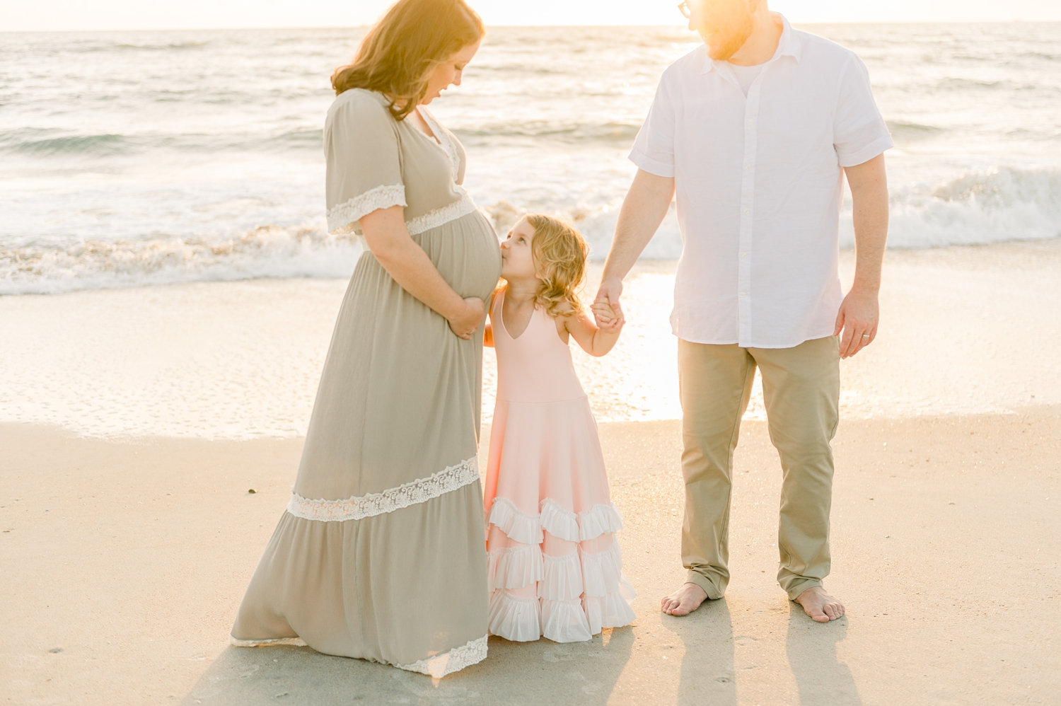 sunrise family beach maternity portrait, mother with husband and daughter