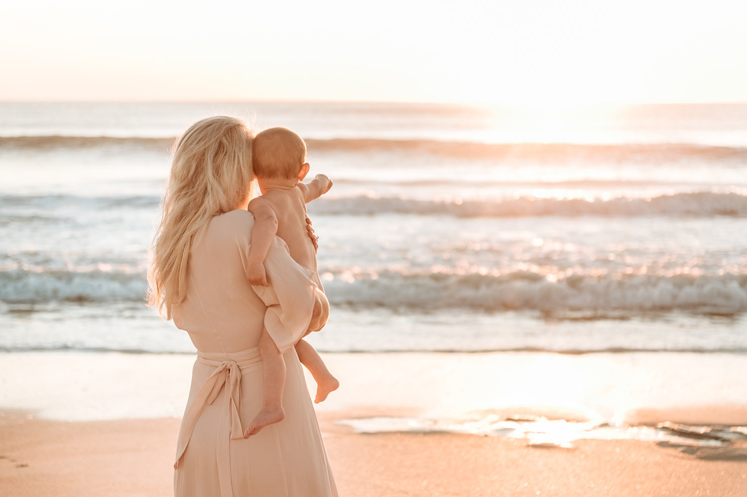 blonde mother and baby staring into the ocean, coastal motherhood session, Ryaphotos