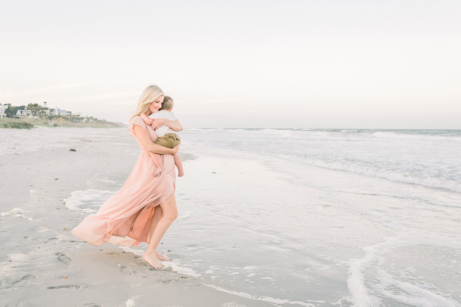 mother embracing toddler son on the beach, Ponte Vedra Beach, Florida, Ryaphotos